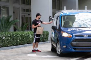 Ford self-driving food delivery Postmates
